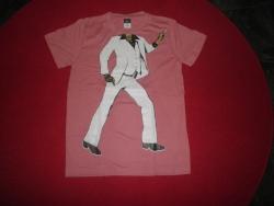 Päätön paita, Travolta